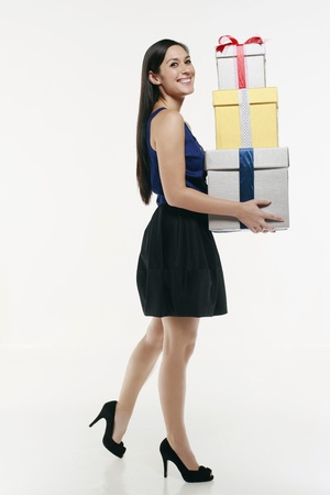 Woman with a stack of gift boxes Stock Photo - 10572619
