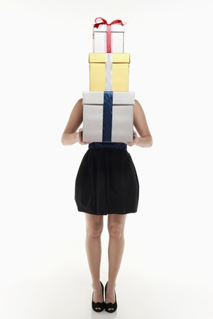 Woman with a stack of gift boxes photo