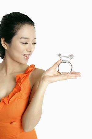 Woman holding a gigantic diamond ring Stock Photo - 10862042