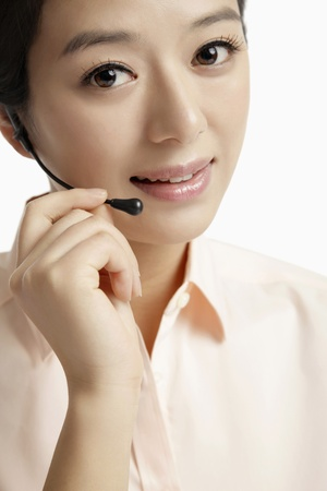 Businesswoman with telephone headset Stock Photo - 10862026