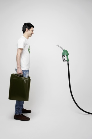 gas can: Man with gas can face to face with fuel pump