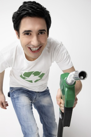 Man holding a petrol pump photo