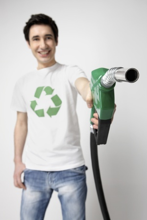 environmental issues: Man holding a petrol pump Stock Photo