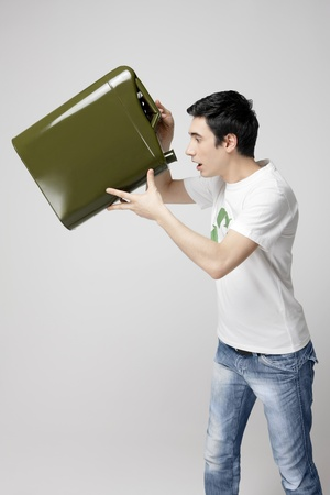 gas can: Man looking into an empty gas can Stock Photo