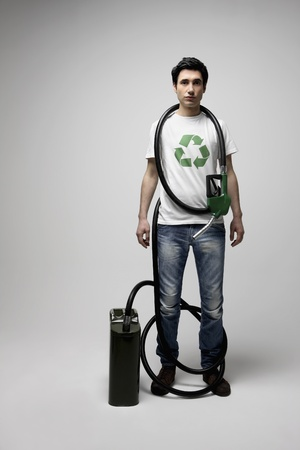 gas can: Man with gas pump and gas can Stock Photo