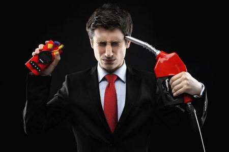 Businessman with time bomb and fuel pump photo