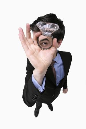 Businessman holding a gigantic diamond ring photo