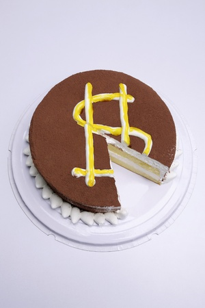 Chocolate Cake with a dollar sign and slice cut in it photo