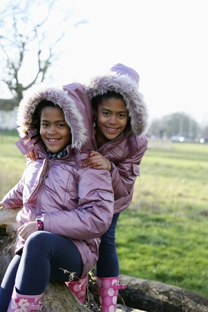 Girls in warm clothing having fun in the park Stock Photo - 10862109