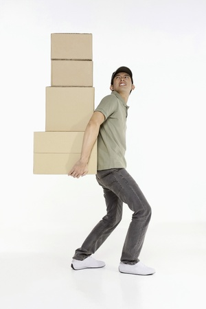 man side: Man carrying a stack of packages Stock Photo