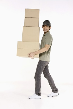 Man carrying a stack of packages photo