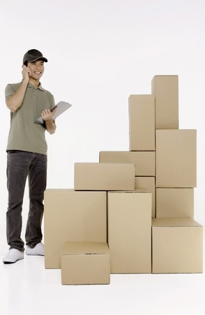 Man talking on the phone while checking packages photo