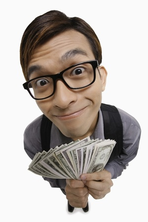 Businessman with a big smile holding money
