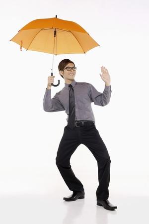 Businessman with an umbrella photo