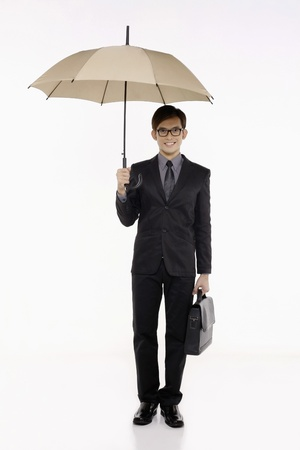 people walking white background: Businessman with umbrella and briefcase