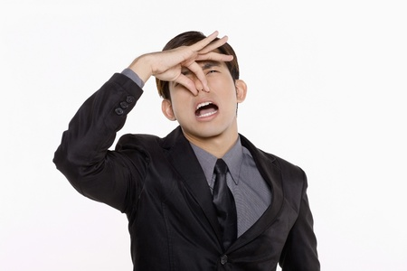Businessman pinching his nose photo
