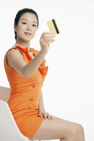 Woman showing credit card Stock Photo - 12514694