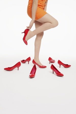 red shoes: Woman trying on shoes