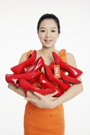 Woman with an armful of shoes photo