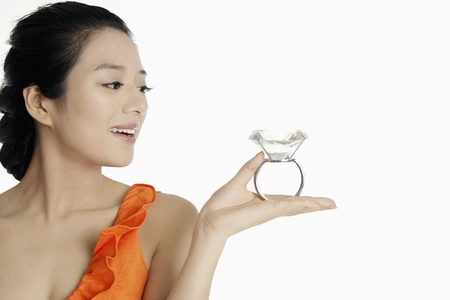 Woman holding a gigantic diamond ring photo