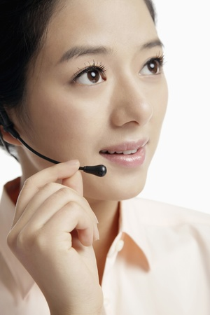Businesswoman with telephone headset Stock Photo - 12514708