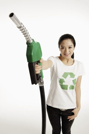 Woman holding a petrol pump photo