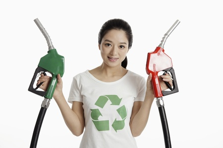 Woman holding a green and a red petrol pump photo