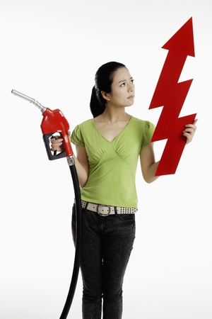 Woman holding a red petrol pump and an up arrow photo