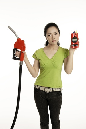 Woman holding a red petrol pump and a time bomb photo
