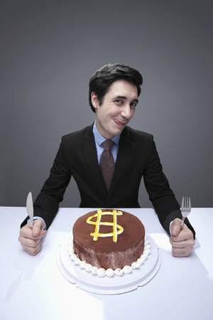 Businessman eating cake photo