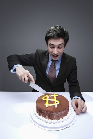 Man Sitting In Front Of Birthday Cake Cheering Stock Photo Picture
