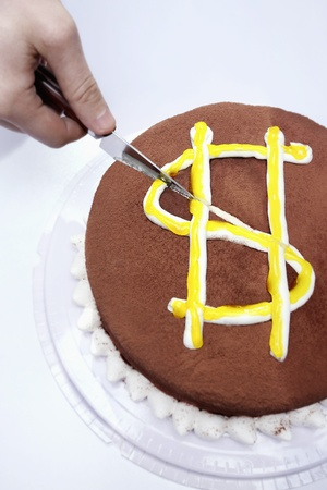 Knife on cake with dollar sign photo