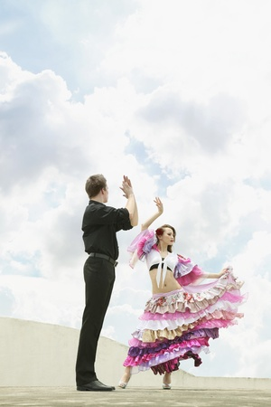Man and woman dancing the Flamenco photo