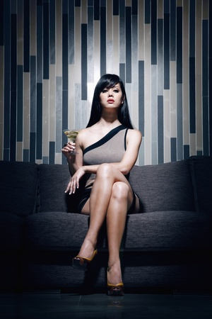 Woman with a glass of martini photo