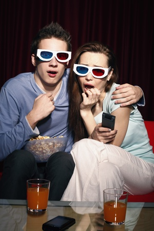 Man and woman watching 3D movie photo