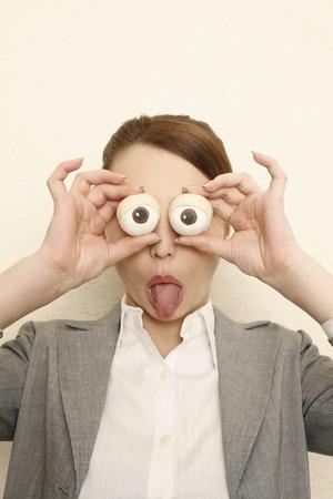 Businesswoman with fake eyes photo