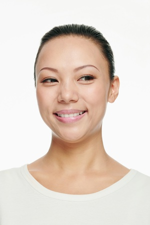 Woman smiling while looking to the side photo