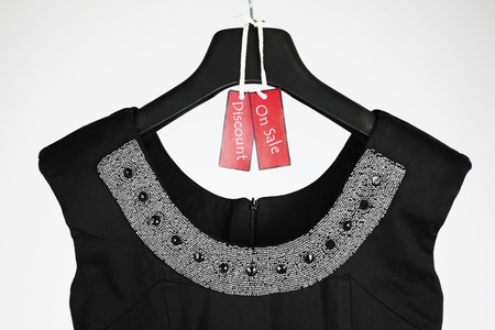 coathanger: Dress with sale tag on it