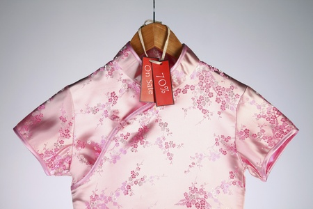 Pink cheongsam on hanger with discount tag Stock Photo - 13148996