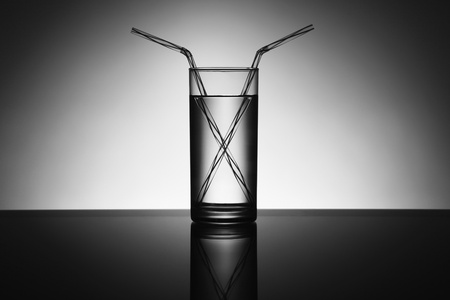 Glass of water with two drinking straws Stock Photo - 13147189