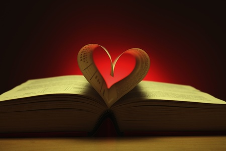 literatures: Heart shape formed from pages in book Stock Photo