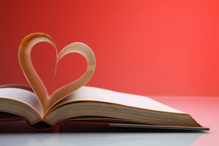 Heart shape formed from pages in book Stock Photo