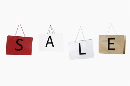 Shopping bags with the word SALE Stock Photo - 13147171
