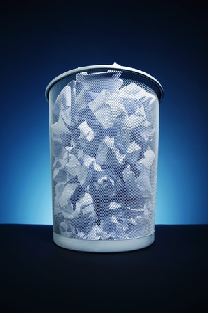 wastepaper basket: Wastepaper basket full of crumpled papers Stock Photo