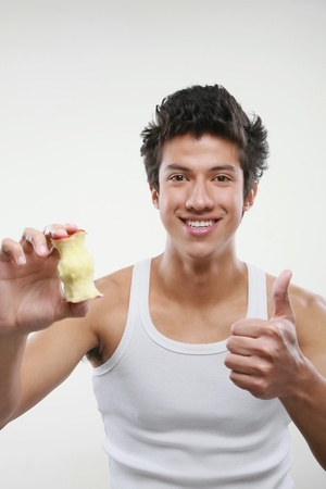 apple core: Man holding an apple core showing thumbs up Stock Photo