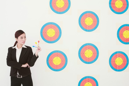 Businesswoman holding darts photo