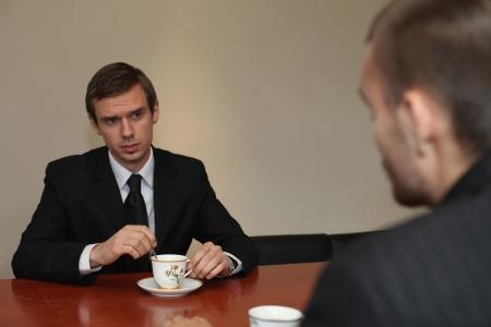 Businessmen having discussion over tea Stock Photo - 13341529