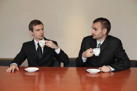 scandinavian descent: Businessmen having tea together