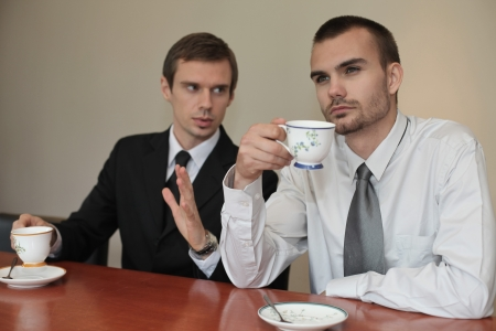 Businessman talking to his colleague who is daydreaming Stock Photo - 13341553