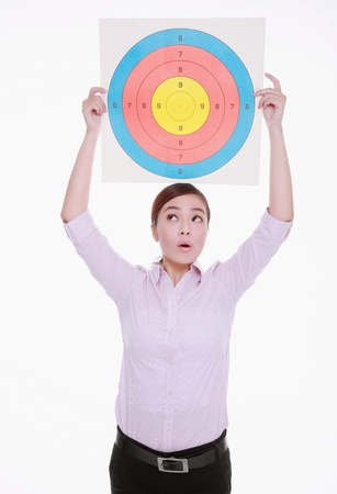 office politics: Businesswoman holding target above her head